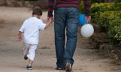 little boy holding fathers hand. Image shot 2011. Exact date unknown.